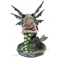 Figurine La fée le papillon et le chat noir 16 cm
